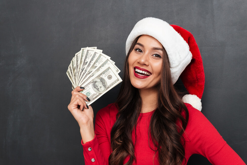 Woman holding title for cash loan.